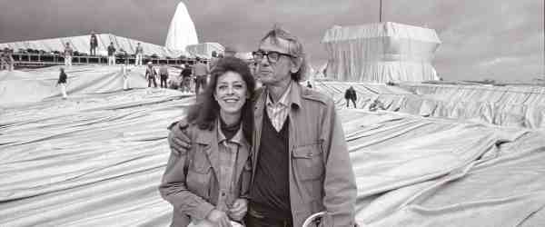 Christo and Jeanne Claude during the installation of Wrapped Reichstag, Berlin 1995 photo: Wolfgang Volz © Christo, Wolfgang Volz