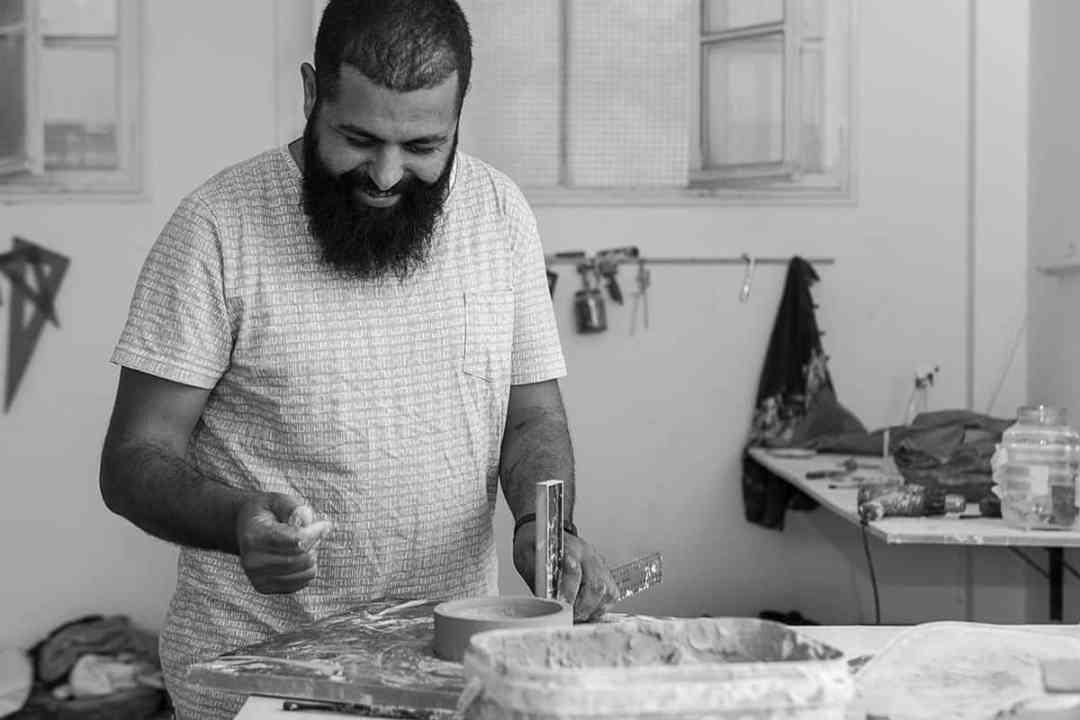 Malek Gnaoui in his studio, ph. Anouar Labidi for Inkyfada