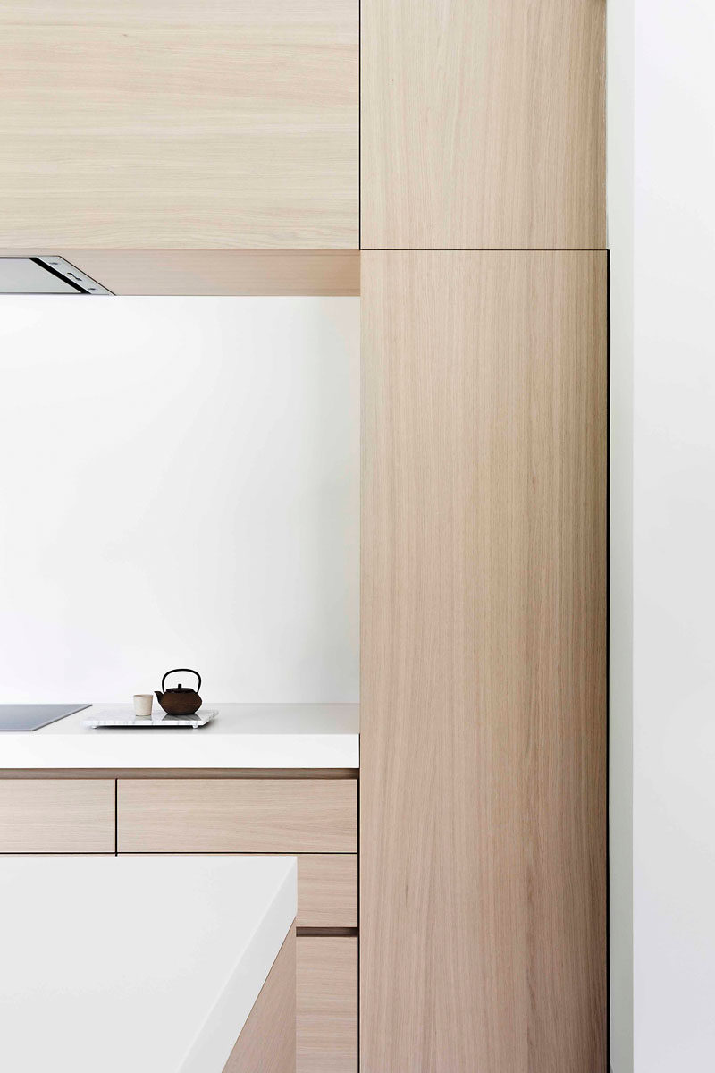 Light Wood And White Countertops Create A Neutral Softness