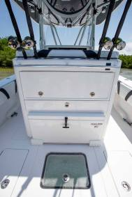 Tackle center and slide out cooler with rodholders Contender Boats ST  interior