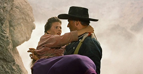 искатели старого западного фильма фильм Джон Уэйн перевозящих женщину