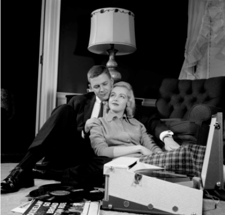 vintage couple cuddling listening to record player vinyl
