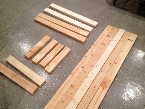 Cut piles of wood for homemade bench.