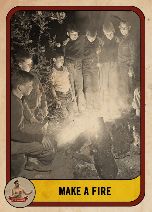 vintage group of boys standing around a campfire