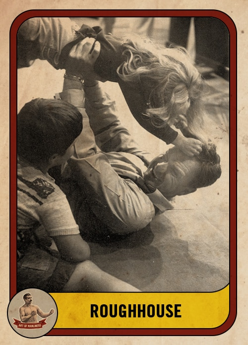 vintage dad roughhousing wrestling with kids