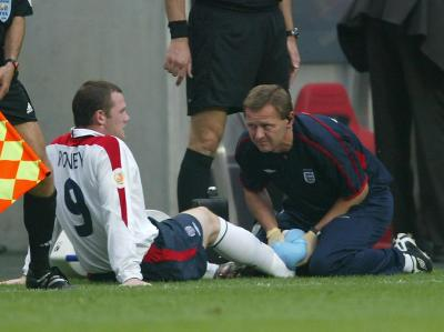 England's Wayne Rooney receives treatment at Euro 2004