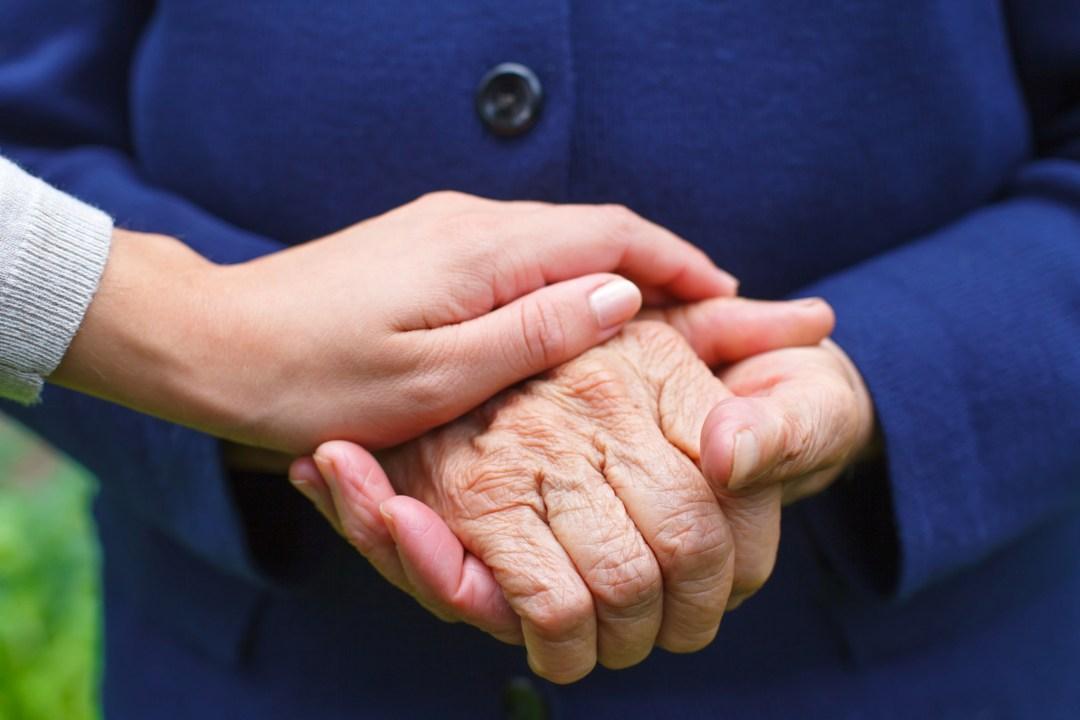 Women holding hands.