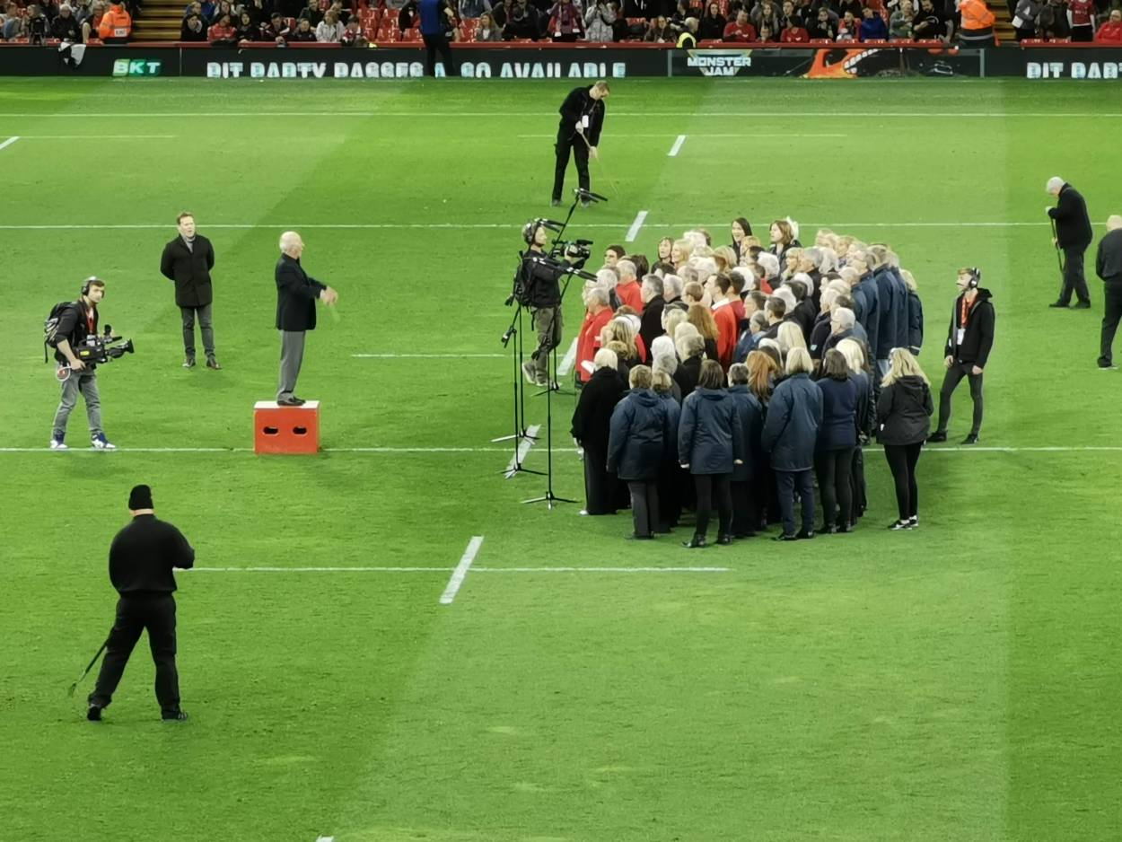 A zoom shot of the choir in the Principality Stadium, Cardiff