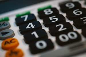 Closeup of the black and white number keys on a basic calculator.