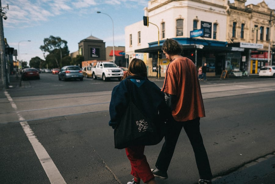 Couple walking around a downtown area