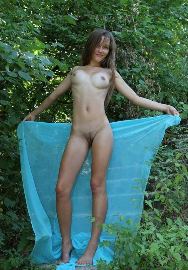 Young Naked Girl Is Showing Her Slim Body 1