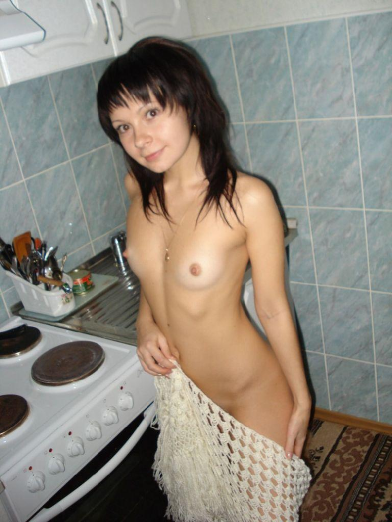 Cute brunette is posing at home - 1