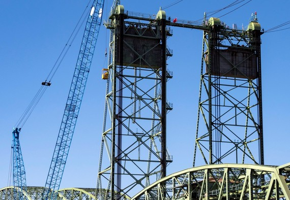 Crews are lifted to the top of the tower to prepare the bridge for the September maintenance work.