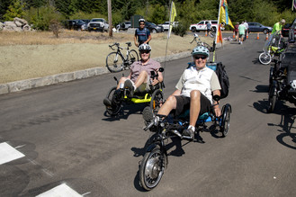 People using recumbent bikes on the trail.
