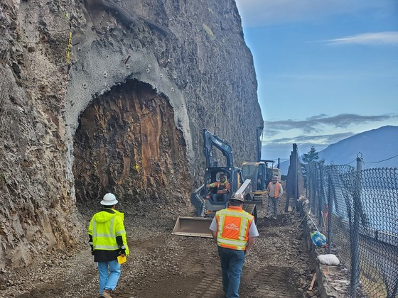 Crews excavate to form the east portal or tunnel entrance.
