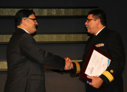 Photo of Rear Admiral Ken Castro, MD, receiving a Lifetime Achievement Award from USAID's Assistant Administrator for Global Health