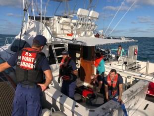 Coast Guard, TowBoatUS rescue three people taking on water near Key Largo