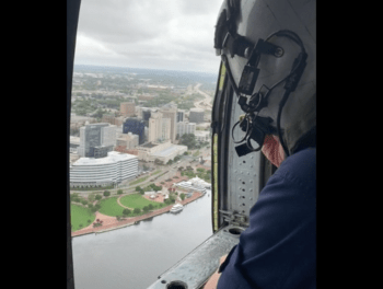 U.S. Coast Guard and Navy conduct overflight in helicopter