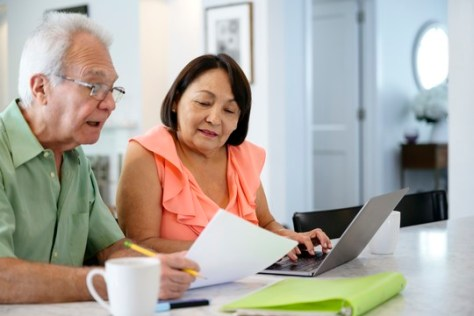 Senior couple using laptop to organize financial plan