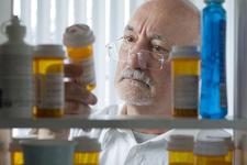 Man looking at prescription drugs