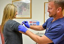 Doctor giving a flu shot