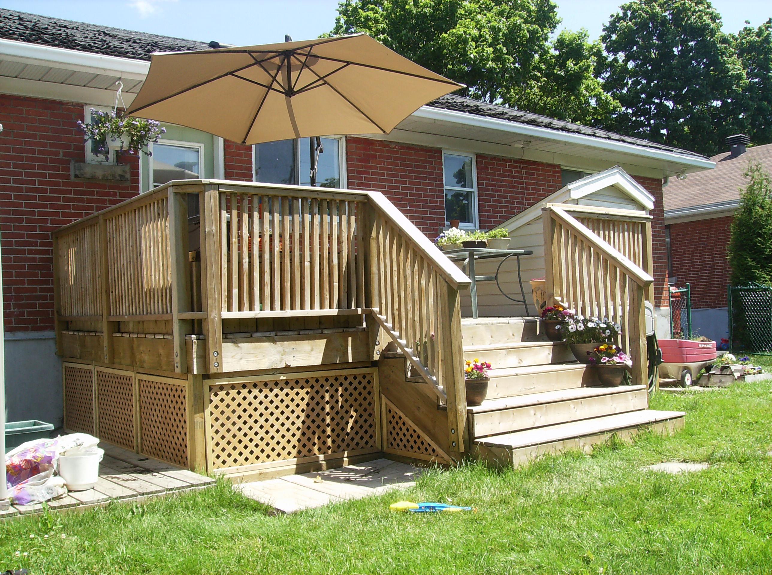 building a wooden deck over a concrete