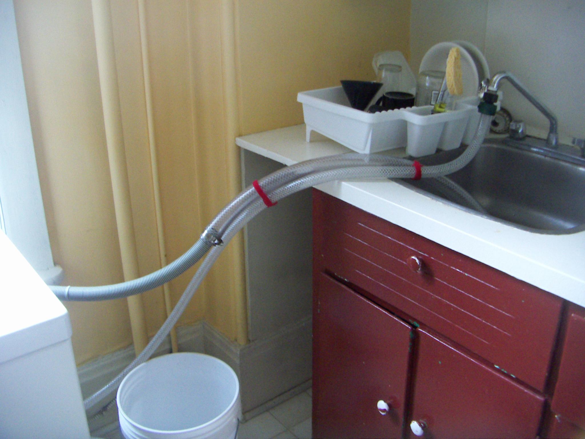 a washing machine to a kitchen sink