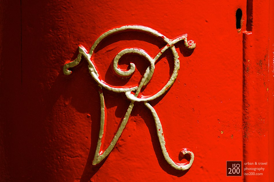 Queen Victoria's initials in gold on a red Royal Mail postbox, Sheffield, England