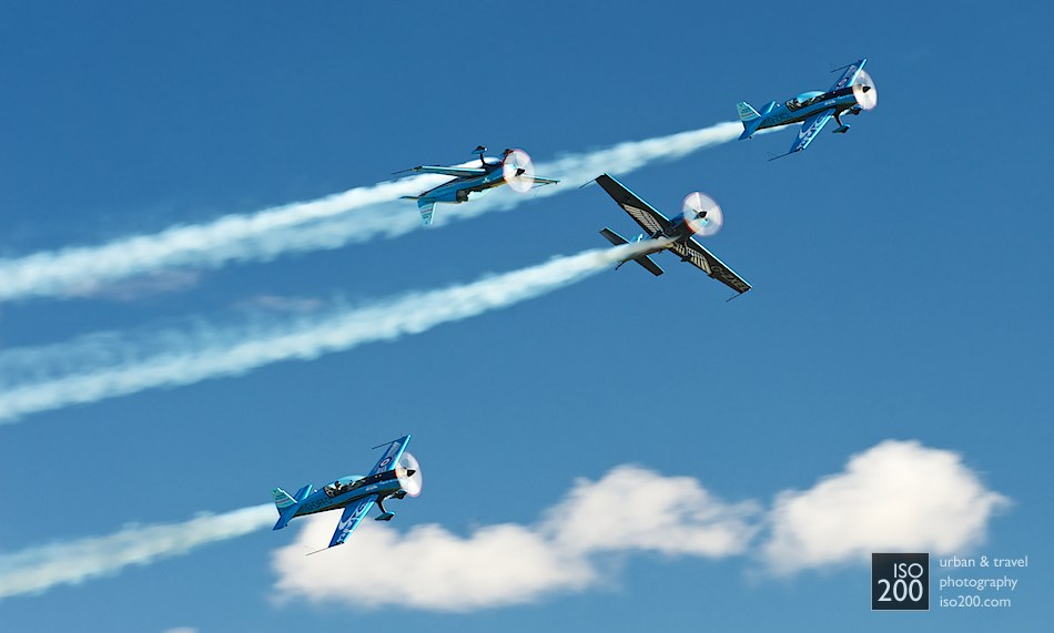 Four Extra EA 300L aeroplanes from the Blades Aerobatic team cavort at the 2010 Leuchars Air Show.