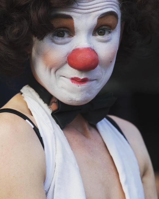 Portrait of a clown on the Royal Mile during the Edinburgh Fringe Festival.