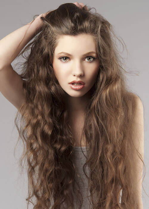15 Tried And True Hairstyles For Long Curly Hair