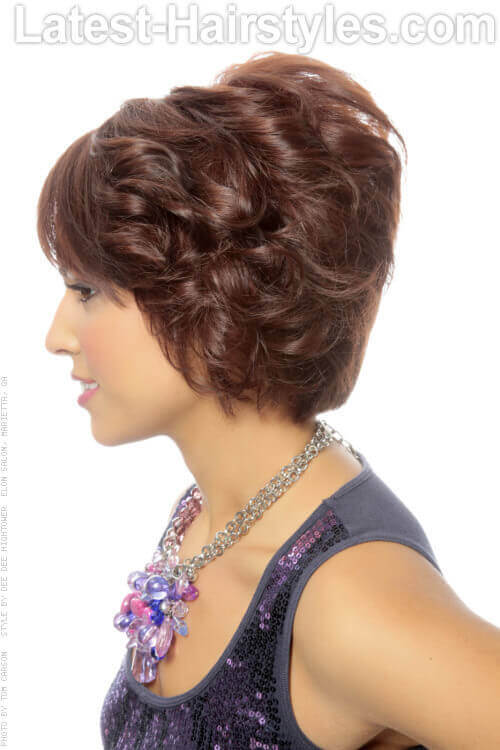 Layered Bob Hairstyle with Curls and Fringe Side