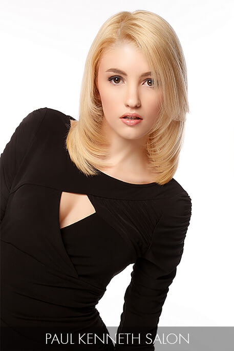 Attainable and maintainable, buttery-blonde strands are styled to perfection with long layers that draw attention to the neck and shoulders.