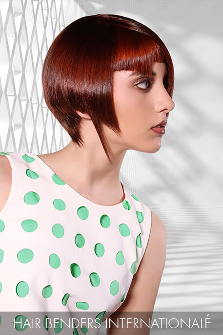 Make your own hair rules! Geometric angles give this ruby red hue the flair it needs to succeed in creating a unique approach to style today.