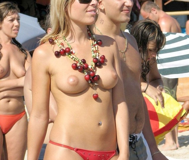 Topless And Nude On The Beach
