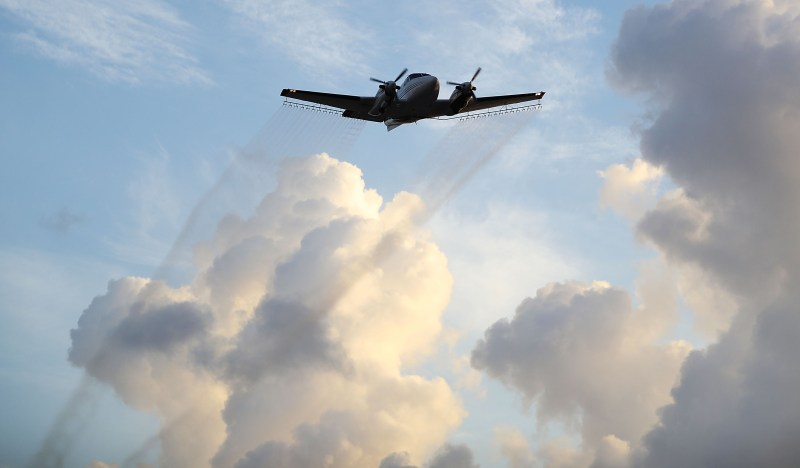 A plane spraying mosquito pesticide. (Joe Raedle/Getty Images)