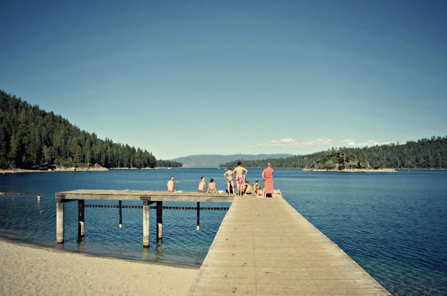 View of Lake Tahoe from the jetty with people standing on the jetty