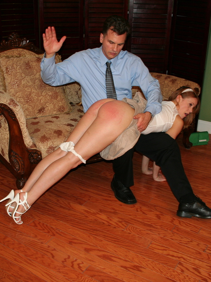 Sassy redhead daughter receiving a hard spanking by daddy