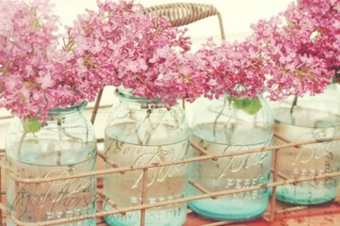 Recycled blue jars with pink flowers
