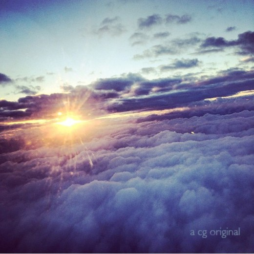 a contented gypsy original photo of a blue and purple sunrise while inflight