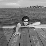 Adam hanging from a dock.