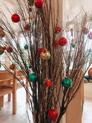 dried twigs decorated iwth christmas baubles