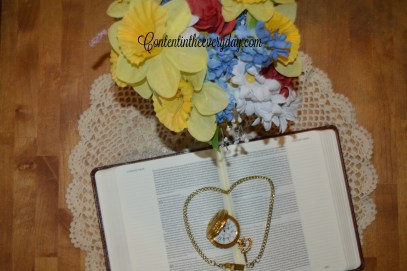 Open Bible with pocket watch and flowers