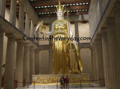Kids standing with the godess Athena