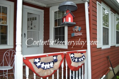 House decorated with patriotic bunting