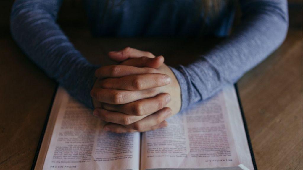 benefits of prayer decorative image hands on bible man