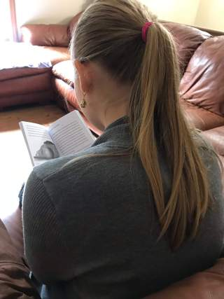 girl reading barbour book