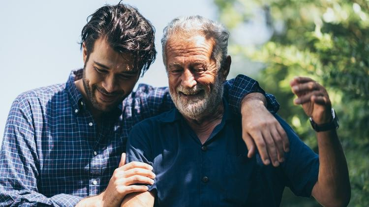 Father and son, elderly receive support - iStock - iStock