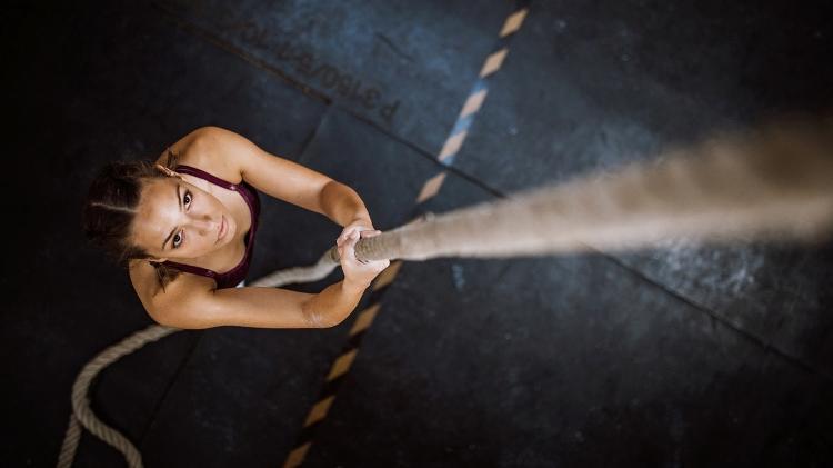 Rope climbing, crossfit, training, focus, determination - iStock - iStock