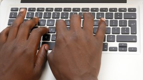African-stock-video-of-black-man-hands-typing-on-a-laptop-computer